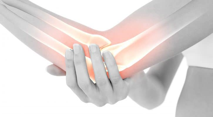 Digital composite of highlighted bones of woman with elbow pain